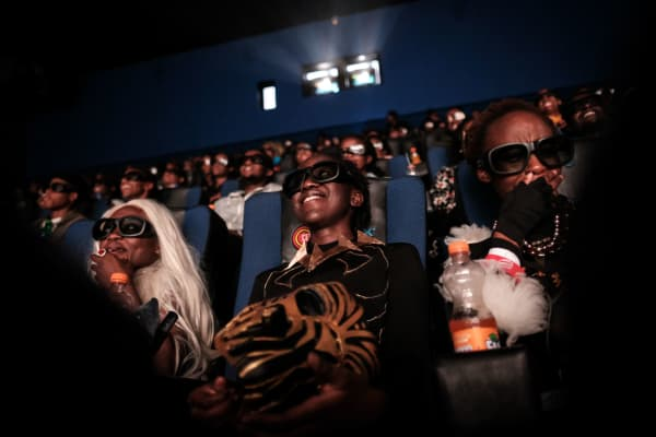Cosplayers watch the film 'Black Panther' in 3D during Movie Jabbers Black Panther Cosplay Screening in Nairobi, Kenya, on February 14, 2018.