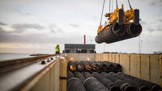 Nord Stream 2 pipes are loaded onto a vessel in the northern German port of Mukran for transshipment to a storage yard.