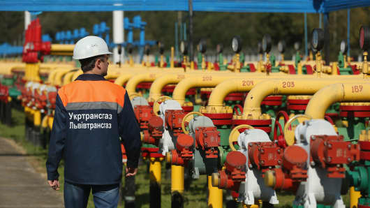 A worker walks among pipes and valves at the Dashava natural gas facility in Dashava, Ukraine.