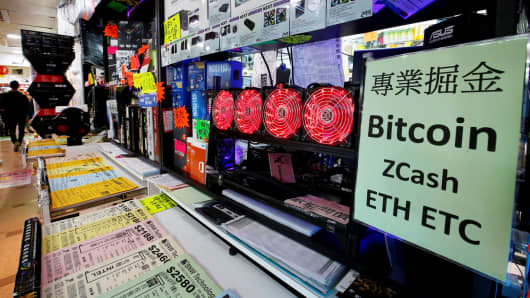 A cryptocurrency mining computer equipped with four cooling fans is seen on display at a computer mall in Hong Kong, January 29, 2018.