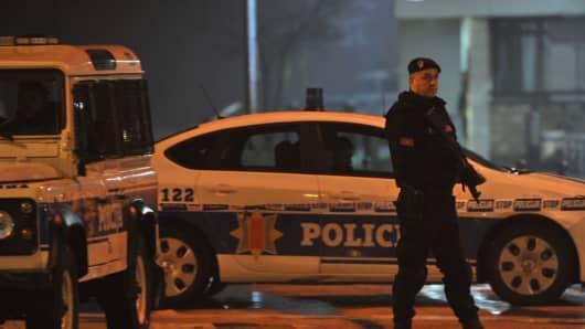 Police block off the area around the U.S. embassy in Montengro's capital, Podgorica.