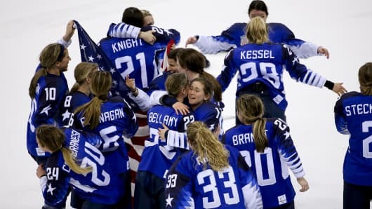 Players of Team USA celebrate winning the gold medal after penalty-shot shootout following the Women's Ice Hockey Gold Medal game final between USA and Canada