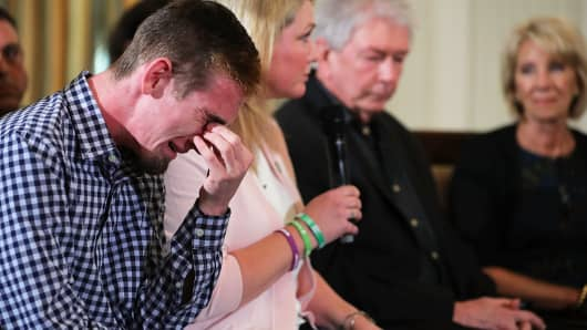 Marjory Stoneman Douglas High School senior Samuel Zeif weeps after talking about how his best friend was killed during last week's mass shooting while he participates in a listening session hosted by U.S. President Donald Trump in the State Dining Room at the White House February 21, 2018 in Washington, DC.