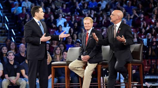 Senator Marco Rubio (L) and Congressman Ted Deutch disagree during a CNN town hall meeting, at the BB&T Center, in Sunrise, Florida, February 21, 2018.