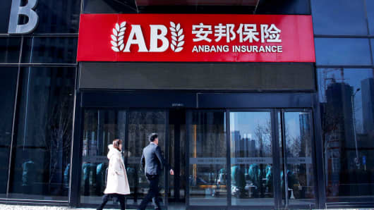 People enter the office of Anbang Insurance Group in Beijing, China, February 23, 2018.