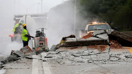 Construction crews work on a section of Interstate 20 West that buckled in Decatur, Ga.