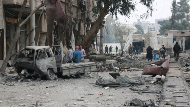 Damaged buildings and a vehicle are seen after Assad regime forces carried out airstrikes over the deescalation zone in Arbin town of Eastern Ghouta in Damascus, Syria on February 23, 2018.