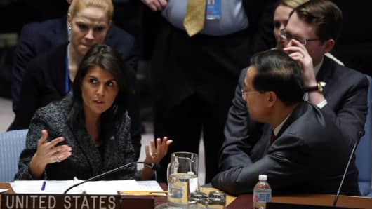 US Ambassador to the United Nations speaks to Ambassador MA Zhaoxu (R) of China before voting on Sweden's Syria ceasefire resolution during a Security Council meeting at the UN HQ in New York, United States on February 24, 2018.