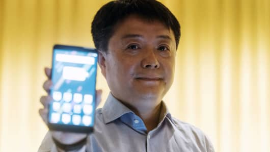 Wang Xiang, head of international at Xiaomi, holds a Mi Max 2 smartphone for a photograph during a news conference in Hong Kong, China, on Monday, June 26, 2017.