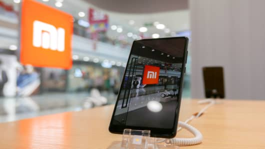 A Xiaomi smartphones sits inside one of its stores.