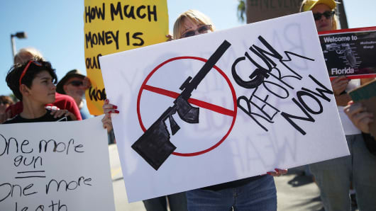 Activists protest in front of Kalashnikov USA, a gun manufacturer that makes an AK-47 rifle, on February 25, 2018 in Pompano Beach, Florida.