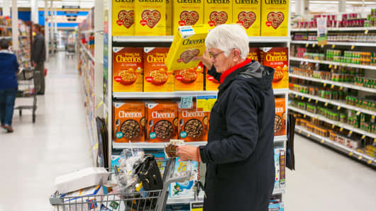 A woman shops for Cheerios cereal at a Price Chopper supermarket in South Burlington, Vermont.