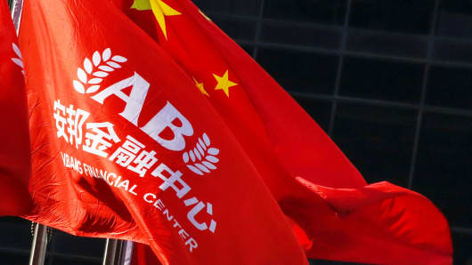 A company flag and the Chinese national flag fly outside the headquarters of Anbang Insurance Group in Beijing, China, February 23, 2018.