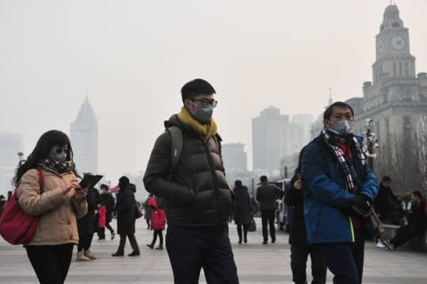People visit the Bund which is plagued by heavy smog on January 30, 2018 in Shanghai, China.