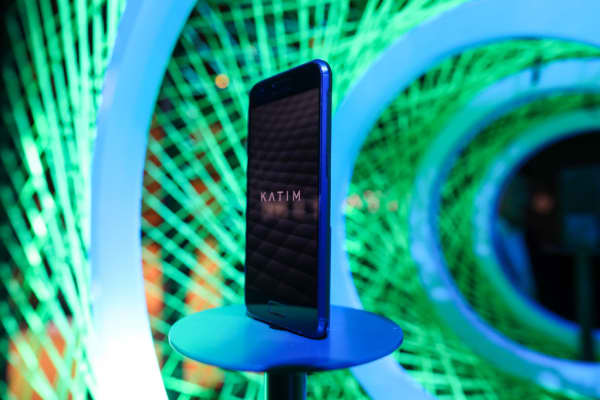 A KATIM smartphone, manufactured by DarkMatter, sits on display at Mobile World Congress.