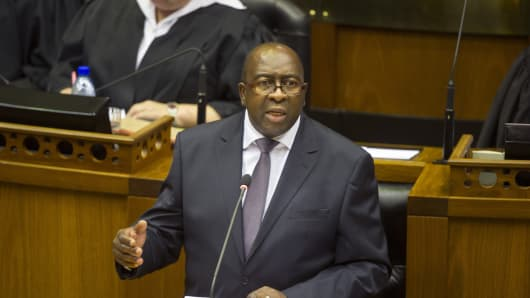 South African Minister of Finance Nhlanhla Nene delivers the 2015 budget speech at the National Assembly in Cape Town on February 25, 2015.