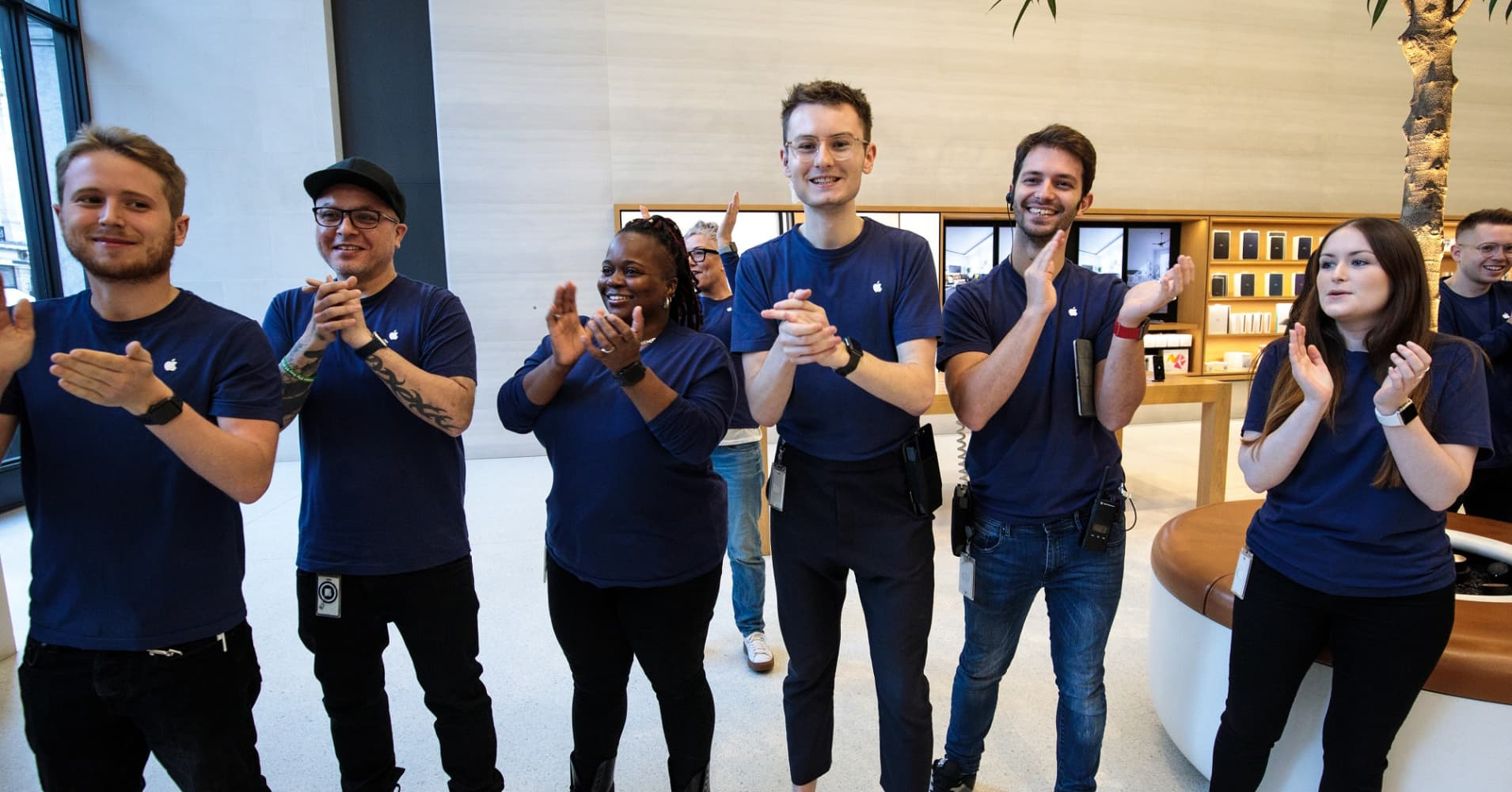 Apple employees clap