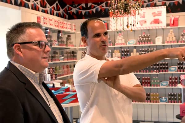 "Travis Lee (L) and Marcus Lemonis (R) stand in the newly renovated Farrell's restaurant during ""The Profit."""