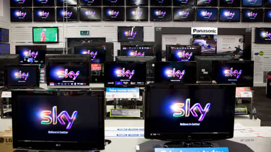 The sky logo is displayed on televisions at a Currys store in London, U.K.