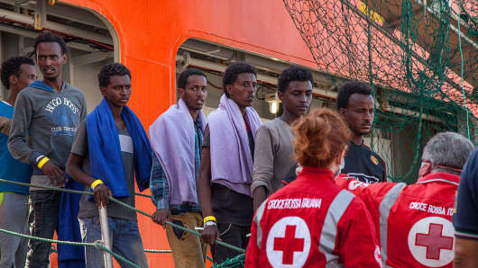 Scores of migrants arriving in Sicily after attempting to cross the Mediterranean Sea. The majority of the migrants hail from from Sudan, Eritrea and Syria.