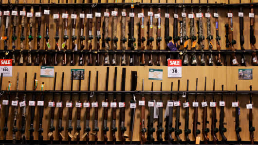 Guns sit on display at a Dick's Sporting Goods Inc. store in Paramus, New Jersey.