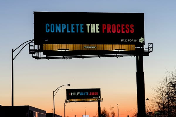 Two of the billboards from Power Home Remodeling urging LeBron James to sign with the Philadelphia 76ers.