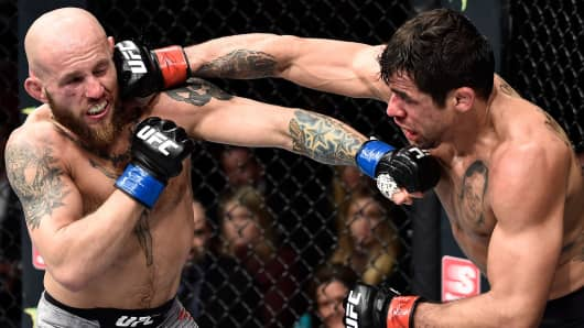 Renan Barao of Brazil punches Brian Kelleher in their bantamweight bout during the UFC Fight Night event at Amway Center on February 24, 2018 in Orlando, Florida.