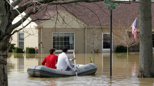 Louisville residents are forced to use boats and kayaks to get to their homes along the Ohio River after it flooded Louisville, Kentucky, February 25, 2018.