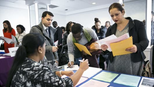 A New York Department of City Administrative Services representative, left, speaks with job seekers during a Catalyst Career Group job fair in New York, Feb. 7, 2018.