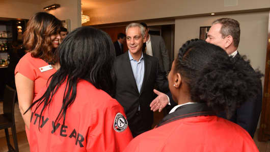 Chicago Mayor Rahm Emanuel talks to City Year Chicago corps members at a fundraiser hosted by GMM Nonstick Coatings CEO Ravin Gandhi in January 2018.