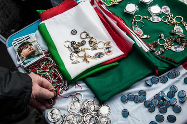 Souvenirs depicting Benito Mussolini and fascism are displayed on a stall.