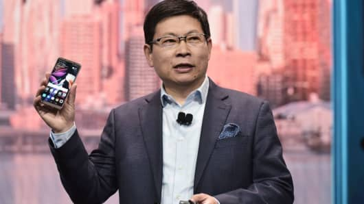 Huawei consumer business CEO Richard Yu speaks about the Mate 10 Pro phone during a keynote address during CES 2018 in Las Vegas on January 9, 2018.