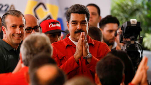 President Nicolas Maduro gestures as he registers his candidacy for re-election at the National Electoral Council (CNE) headquarters in Caracas, Venezuela February 27, 2018.