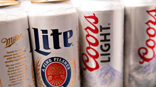 Cans of Molson Coors Brewing Co. Miller Lite and Coors Light brand beer