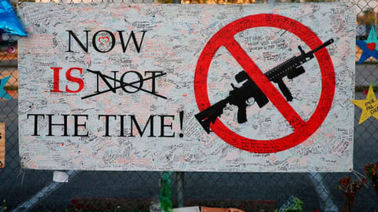 A sign hangs on a fence at Marjory Stoneman Douglas High School in Parkland, Florida on February 27, 2018.