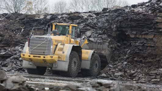 A wheel loader truck, manufactured by Volvo AB, collects kerogen shale rocks from a quarry operated by Holcim Ltd. in Dotternhausen, Germany, on Thursday, Nov. 13, 2014. Oyak Group, Turkey's military pension fund, has $2 billion in cash for acquisitions and may spend some of it on assets from cement makers Holcim and Lafarge