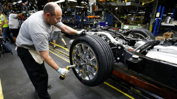 A worker builds a Ford Expedition SUV as it goes through the assembly line at the Ford Kentucky Truck Plant in Louisville, Kentucky.