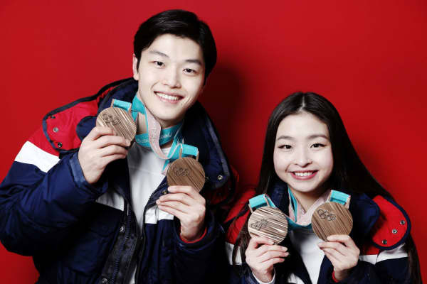Maia and Alex Shibutani pose with their Olympic bronze medals.