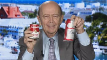 Commerce Secretary Wilbur Ross holds up a Campbell's Soup and Budweiser cans commenting on the US aluminum and steel tariff trade policy.