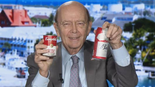 Commerce Secretary Wilbur Ross holds up a Campbell's Soup and Budweiser cans commenting on the US aluminum and steel tariff trade policy