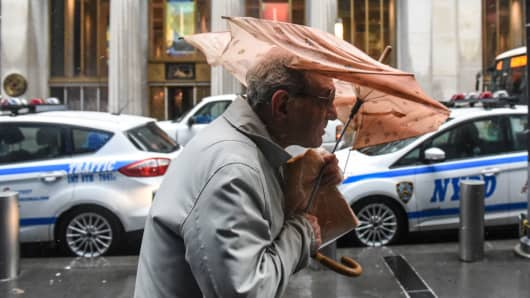 A person struggles with their umbrella during a large storm on March 2, 2018 in New York, New York. A nor'easter is set to slam the East Coast on Friday, bringing coastal flooding, heavy snow and strong winds to the area.
