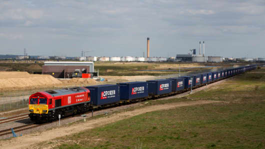 A freight train transporting containers laden with goods from the UK departs from Corringham, east of London, on April 10, 2017, enroute to Yiwu in the eastern Chinese province of Zhejiang.