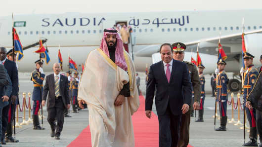 Crown Prince and Defense Minister of Saudi Arabia Mohammad bin Salman al-Saud (L) is welcomed by Egyptian President Abdel Fattah al-Sisi (R) at Cairo International Airport in Cairo, Egypt on March 04, 2018.