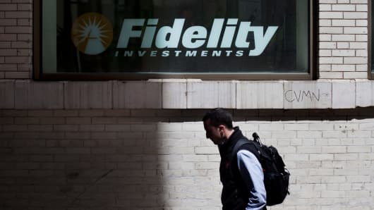 A pedestrian passes a Fidelity Investments branch in New York.