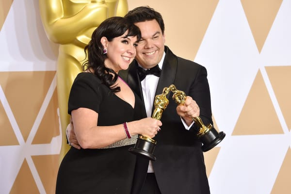 Kristen Anderson-Lopez and Robert Lopez attend the 90th Annual Academy Awards on March 4, 2018 in Hollywood, California