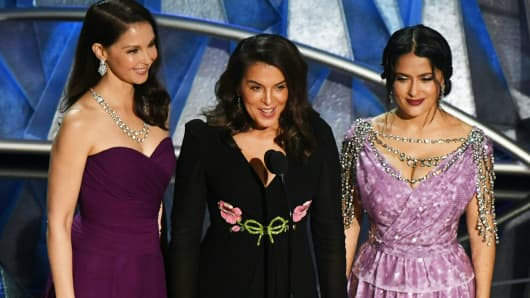 Actress Ashley Judd, US-Italian actress Annabella Sciorra and Mexican-Lebanese actress Salma Hayek deliver a speech about sexual harassment in the entertainment industry during the 90th Annual Academy Awards show on March 4, 2018 in Hollywood, California.
