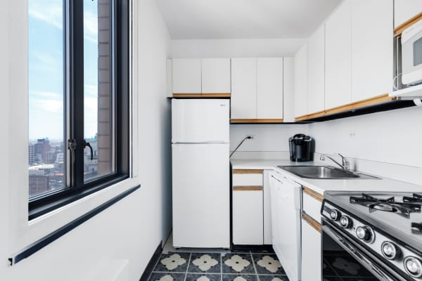The kitchen of a studio apartment in the Ascot in New York City.