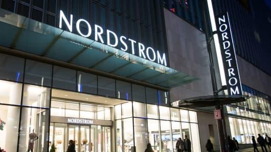 Pedestrians walk past a Nordstrom Inc. store.
