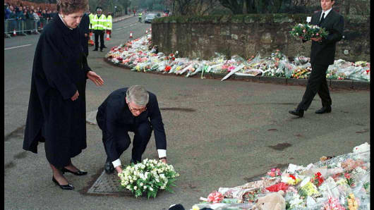 Prime Minister John Major with wife Norma lays floral tribute at Dunblane after the shooting tragedy on March 17, 1996.