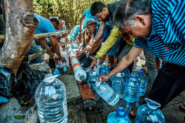 Cape Town residents queue to refill water bottles at Newlands Spring on January 31, 2018, in Cape Town, South Africa.